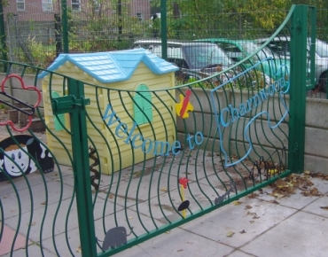 Gates with words, patterns and creatures, for a Stockport nursery school