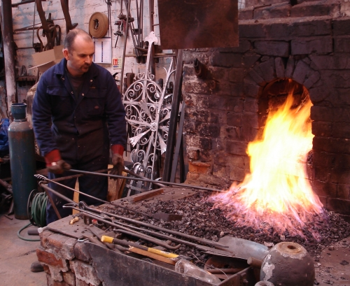 Martin forging the bars to form reeds