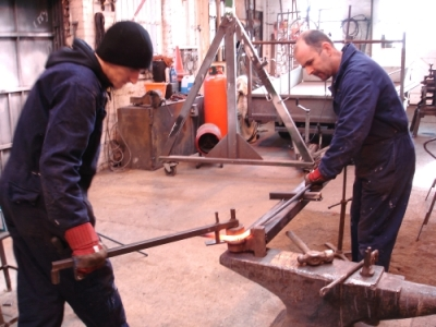 Carl and Martin forming the reed shapes using the jig