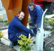 Martin and Carl installing large amphora sculpture designed by Adrian Moakes