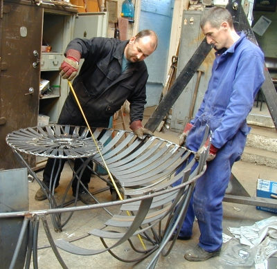 Martin and Carl working on Ironstone Bench, designed by Adrian Moakes